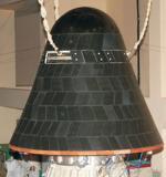 Návratové těleso SRE-1 se systémem tepelné ochrany na povrchu.