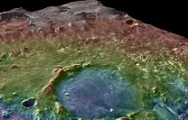 Kráter Jezero na Marsu při šikmém pohledu. Vzadu/nahoře západní delta, dole výtokový kanál Autor: NASA/MSSS/ASU/GSFC