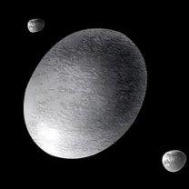 Představa vzhledu trpasličí planety Haumea a jejích průvodců Autor: NASA/STScI