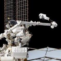 Záběr NASA TV z kamery na ISS během kosmické vycházky 22. 11. 2019 za účelem opravy AMS-02