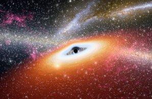 Umělecká představa superhmotné černé díry v centru Galaxie. Autor: Universe Today.