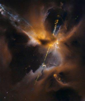 Mladá hvězda s výtrysky ukrytá za závojem prachu a plynu Autor: NASA, ESA