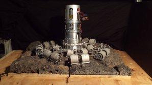 Prototyp robotické paže s vrtáky, které zachytí balvan na povrchu planetky Autor: NASA