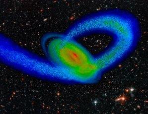 Počítačová simulace srážky naší Galaxie s trpasličí galaxií Sagittarius Autor: Tollerud, Purcell, Bullock/University of California, Irvine