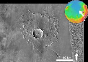 Dvacet osm kilometrů velký impaktní kráter Tooting nacházející se na povrchu Marsu  je charakteristickou ukázkou tečení podloží v okolí místa srážky způsobeného přítomností vodního ledu nehluboko pod povrchem. Autor snímku NASA, upravil Chmee2, licence volné dílo.