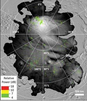 Barevné tečky představují místa, kde byly zaznamenány evropskou sondou Mars Express silné radarové ozvěny pod povrchem jižní polární čepičky Marsu Autor: ESA/NASA/JPL-Caltech